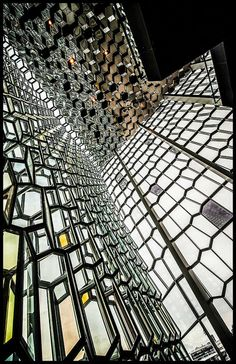 Harpa is a concert hall and conference centre in Reykjavík, Iceland.  Harpa was designed by the Danish firm Henning Larsen Architects