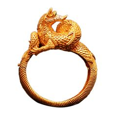 A Unique Fantasy Animal Bracelet by Tiffany | From a unique collection of vintage cuff bracelets at https://www.1stdibs.com/jewelry/bracelets/cuff-bracelets/