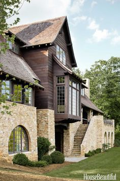 The rear façade features a staircase of Tennessee fieldstone that leads to a covered porch with an outdoor fireplace.