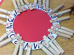 use a laminated paper plate - work on upper and lower case letter recognition