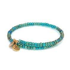 Reach new heights of style with the High Wire Wrap. This elegant mix of glass beads is available in bright hues of Haze, Jasper, Topaz, and Midnight. This wrap is adjustable for a perfect fit and is available in Russian Gold and Russian Silver. Dress up o