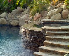 Spa incorporated into naturalistic pool landscaping - really cool