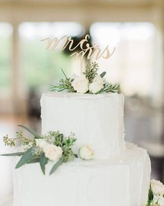 """""""Simple & sweet...love this beautiful cake adorned with our Mr & Mrs topper / flowers by @sweetrootvillage pic by @abbygracephoto #wedding #cake #lasercut"""""""