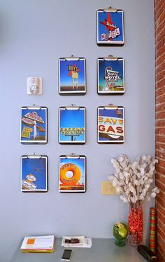 Vintage sign photos hung on clip boards adds a nice punch of color
