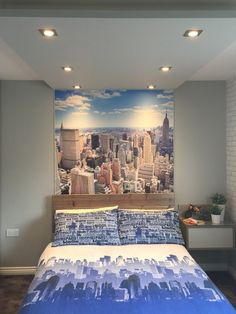Add drama to your bedroom spaces by creating a focal point right above your headboard. We love this city themed bedroom!