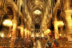 https://flic.kr/p/7bHN8t | The Golden insides of Notre Dame | The inside of the grand cathedral of Notre Dame is a great place for HDR.  Normally, I don't like getting other people in the shot, but sometimes, it's unavoidable.  So, since I use a tripod, I don't mind a bit of motion here and there... seems to give the place a sense of movement and life.  Being in a big Catholic church also reminds me of the four years of Latin I had to take at my Jesuit high school back in the day.  If you…