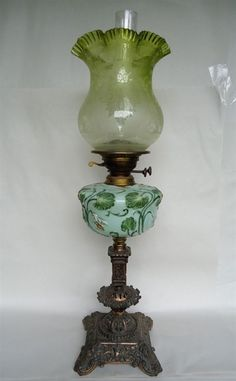 An ornate moulded green glass and metal Victorian oil lamp,… - Lamps - Kerosene/Oil - Lighting