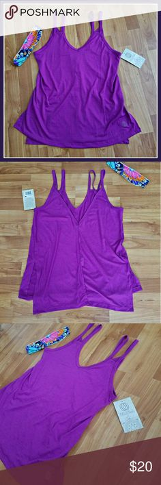Magenta Muse Yoga Tank Soft and Flowing Magenta Muse Yoga Tank. Fashionable,  functional and Feminine.  Deep V back with middle slit.  Accentuates all the right places! Balance Collection Tops Tank Tops