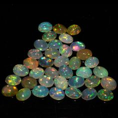 7X9 MM ! CALIBRATED NATURAL ETHIOPIAN OPAL OVAL SHAPE CABOCHON MULTI PLAY COLOR