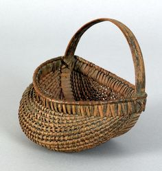 "Small splint hanging wall basket, 19th c., retaining an old blue/green painted surface, 5 1/2"" h., 5 3/4"" w"