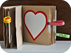 a Valentine booklet! 3 paper bags will create 3 little pockets for hiding little notes or trinkets.