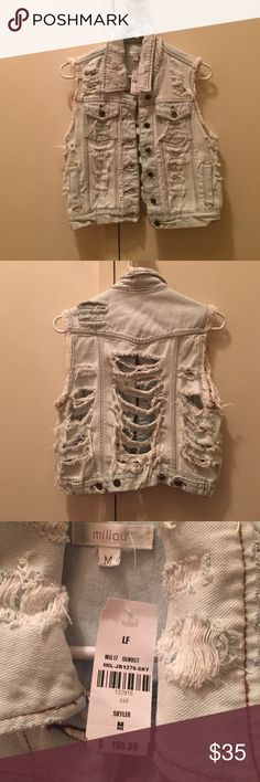 Denim vest New with tags's denim vest light blue denimwith tears in front and back Millau Jackets & Coats Vests