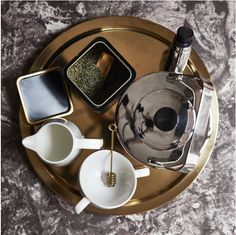 A round gold tray with kettle, mug, milk jug and loose leaf tea inside a container. 5 Gifts, Unique Gifts, Gold Milk, Small Succulent Plants, Winter House, Milk Jug, Loose Leaf Tea, Brass Color, Personality Types
