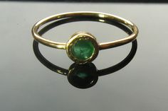 Beautiful, elegant, and handmade ring with natural green emerald set in 14k yellow gold. The emerald is bezel set. The mounting of the stone is hammered and matte. In the back of the ring I cut out a heart-a symbol of love. This adorable ring can be worn alone or as a stack ring. Central