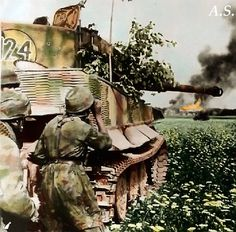 Pzkpfw VI Tiger and German paratroopers in combat on the eastern front.