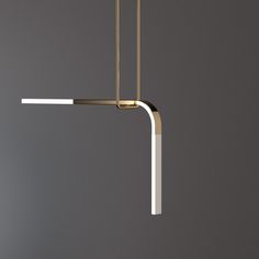 The Acrobat pendant luminaire series is a modular feature light available in various metal finishes with illuminated translucent porcelain arms supported by a suspended trapeze.