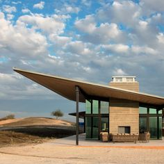 Large sloped roofs shade the winemaking and tasting spaces below, and channel rainwater into an underground tank to be used to irrigate the land around it. Wine Tasting Room, Weathering Steel, Glass Structure, Flat Roof, Wine Country, Pavilion, Architecture Design, United States, California