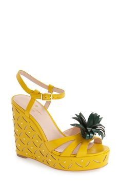 Adding a tropical twist to the look this season with the latest in playful style from Kate Spade. A chic wedge sandal—styled with a pineapple-inspired wedge and decorative leaf at the toe straps—offers fruity-fresh appeal with a signature mix of whimsy and ladylike charm.