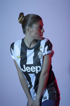 Juventus girl in the dim lightning taking a look around.