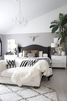 black bedroom furniture neutral bedroom with crystal chandelier, button tufted chaise, black and white accents and leather studded wingback bed - furniture Master Bedroom Design, Home Decor Bedroom, Diy Bedroom, Bedroom Couch, Bedroom Designs, Master Suite, Bedroom Night, Glam Bedroom, Hamptons Bedroom
