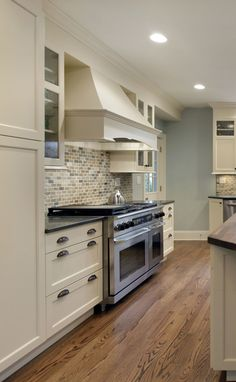 White Kitchen Black Granite what countertop color looks best with white cabinets? | white