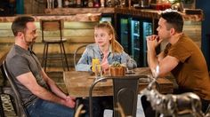 """On """"Coronation Street,"""" committed couple Billy Mayhew (Daniel Brocklebank) and Todd Grimshaw (Bruno Langley) were straight up shocked by the appearance of Billy's ex, Drew Spellman. (Tom Godwin) But nothing could prepare them for his bombshell news: he has a terminal illness. But Drew's appearance b"""