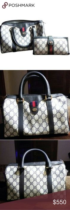 GUCCI Boston Bag Can we say Classical!  This is classic blue intertwined G logo.  NOTHING WRONG WITH THE OUTSIDE... NO Peeling NO Cracking NO Rips, tears, or punctures NO fading  This bag is in excellent condition the only issue is the inside a pen leaked, and normal wear.  Any other questions please contact me Wallet is NOT part of purse...it was my grandmother's and is over 40 years old...just showing as a prop  Yes I trade...Trade value for this is $625 GUCCI Bags Satchels