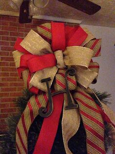 Christmas tree topper bow with -monogram got to find me someone to make a bow for my tree would love to have one like this! wanna make me a bow like this for my tree this year? Burlap Christmas, Christmas Bows, Christmas Tree Toppers, Country Christmas, Christmas Projects, Winter Christmas, Christmas Tree Decorations, Christmas Holidays, Christmas Ideas