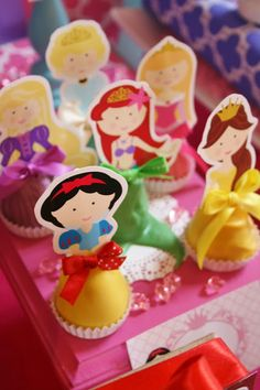 Awesome Cakepop idea - cake pops make up the skirts of the princesses, super cute    And Everything Sweet: Olivia's 4th Birthday!!!