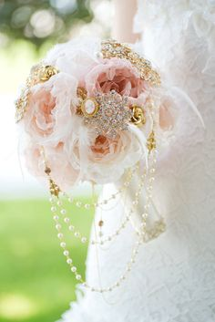 Mlle Artsy rose gold blush cascading fabric flower brooch bouquet