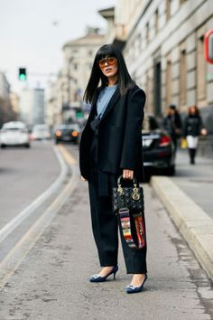 Edgy style with a touch of colored sunglasses  | For more style inspiration visit 40plusstyle.com