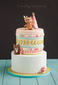 Special woodland tribal baby shower. With native bear, squirrel and teepee. Cutout fondant design on top tier with hand painted herringbone design on bottom tier. Light teal, blue, greens and pinks. Cakes 2014 - My Behance Portfolio