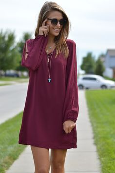 Burgundy Dress. Long sleeves, V neck, solid woven dess with lining. Beautiful burgundy dress. Women's burgundy long sleeve dress, slitted sleeves. A MUST have for the fall! Pair it with a pair of our booties! $49 | Burgundy Dress