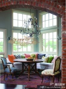 Natural light, brick archway, color combo..dark wood, light colors, pops of brights