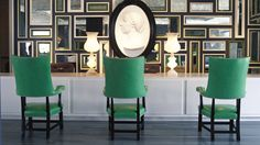 Love the mirrored wall and pop of green.