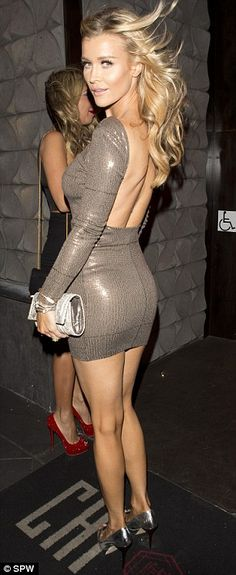 Joanna Krupa.. glittering brown number - backless chic..