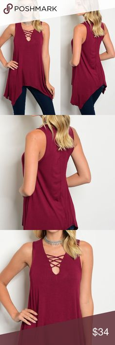 Burgundy Shark Bite Sleeveless Tunic Top Take this updated Basic Top and wear it year round! Fun and flattering Shark Bite Hem. V Neck Criss Cross Front.  Stunning Color! Rayon Spandex. Made in the USA. Tops Tunics