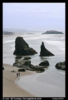 Beach with couple walking amongst sea stacks. Bandon, Oregon, USA (color)