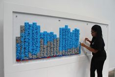 """An installation called """"Pulse"""" from the toy company Mega Blok showed the volume and type of tweets for each hour of the conference. Blue represented Twitter, the most-used social platform.  Photo: Beth Kormanik/BizBash"""