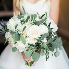 Beautiful wedding bouquet from @flowersbycina ❤ white roses and greenery.  Be inspired by @theinspirassion  Venue: @bacararesortsb | Florals: @flowersbycina | Planner: @kelseyevents | Photo: @bretthickmanphoto
