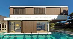 Luigi Rosselli Architects | The Pool House | stained western red cedar sliding shutters and cludding | © Justin Alexander