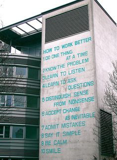 """How to Work Better - Fischli/Weiss    """"Fischli & Weiss How to Work Better (1991). Painted on the wall of an office building, the artists play with the motivational sayings and strategies of the huge corporations that rule our lives and work. The obvious irony and banal treatment here helps to make a break with the corporate and reclaim the language of ordinary common sense."""""""