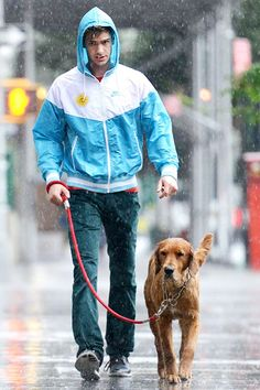 Andrew Garfield walks his dog Ren in a rainstorm in New York on June 13. A wet Andrew Garfield showing real pet owner dedication is totally giving us a ladyboner.