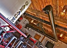 """Garage Coffee Co. in Marathon Village in Nashville. This coffee shop is automotive-themed with motorcycle helmets and accessories as decor and coffee in rev-you-up blends such as """"Road Rage"""" and """"Anger Management"""". The perfect way to start your stroll around Marathon Village."""