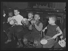 Chicago, Illinois. Ida B. Wells Housing Project. A children's rhythm band in a music class  Delano, Jack, photographer; March 1942  Library of Congress Prints and Photographs Division Washington, D.C. 20540