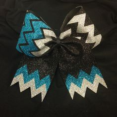 This BOW is handcrafted from only the finest materials, and made to last. featuring the popular Chevron pattern in BLACK, Turquoise & SIlver
