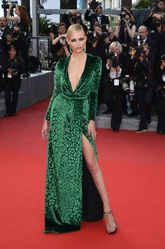 Va-Va-Voom! See the Sexiest Dresses to Hit the Red Carpet in 2012 : Model and actress Natasha Poly showed off her leg via one seriously striking thigh-high split. The beauty donned a daring V-neck green velvet Gucci dress for the Madagascar 3: Europe's Most Wanted Cannes premiere and paired the look with emerald-green drop earrings.