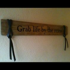 Rustic handcrafted wood sign, adorned with synthetic leather reigns. $40.00, via Etsy.