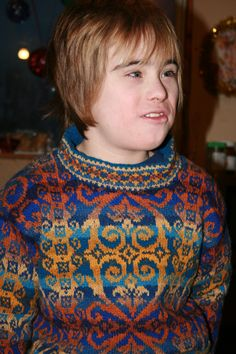 Knit again in 2007 for a child with motifs scaled down and colours re-imagined in blues and golds.