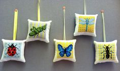 Set of 5 Completed Bug Cross Stitch Pillow by bumblebeedream, $45.00 pinned from http://www.etsy.com/listing/93753499/set-of-5-completed-bug-cross-stitch